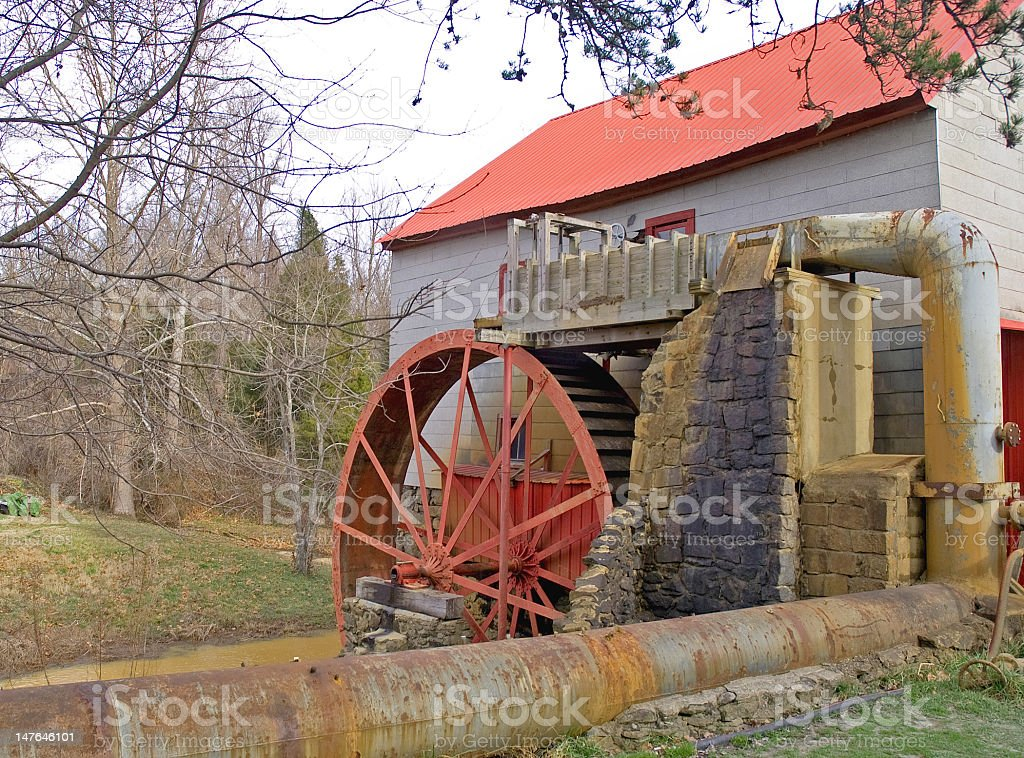 Gristmill With A Red Roof and Wheel royalty-free stock photo