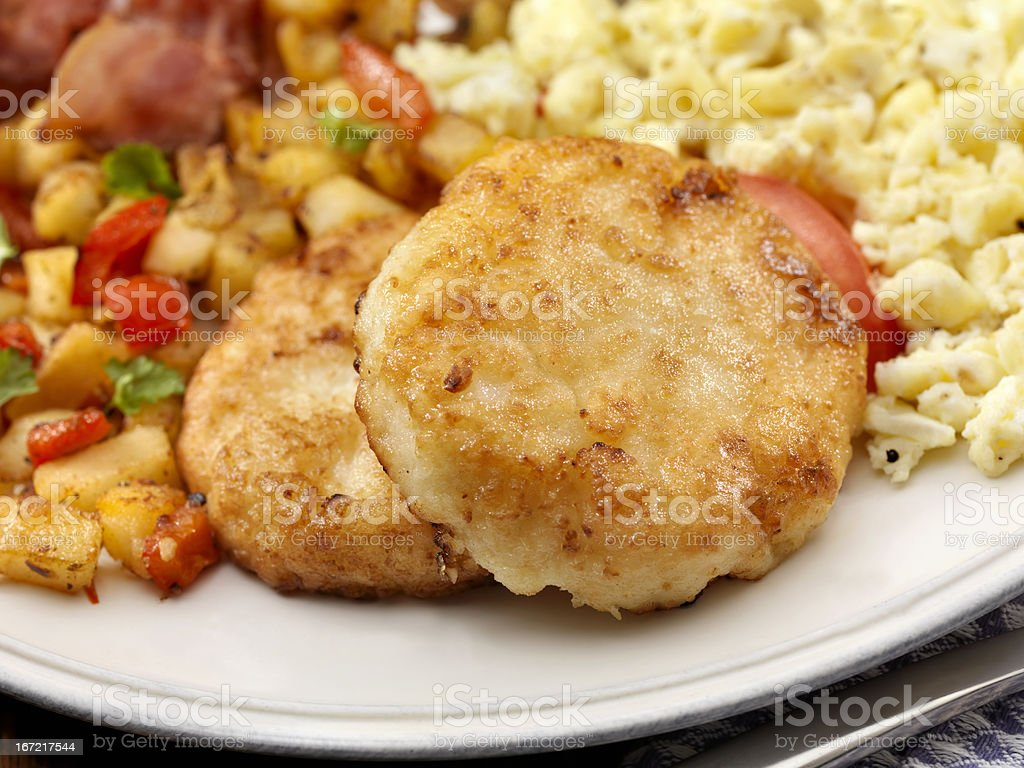 Grit Cakes with Bacon and Eggs royalty-free stock photo