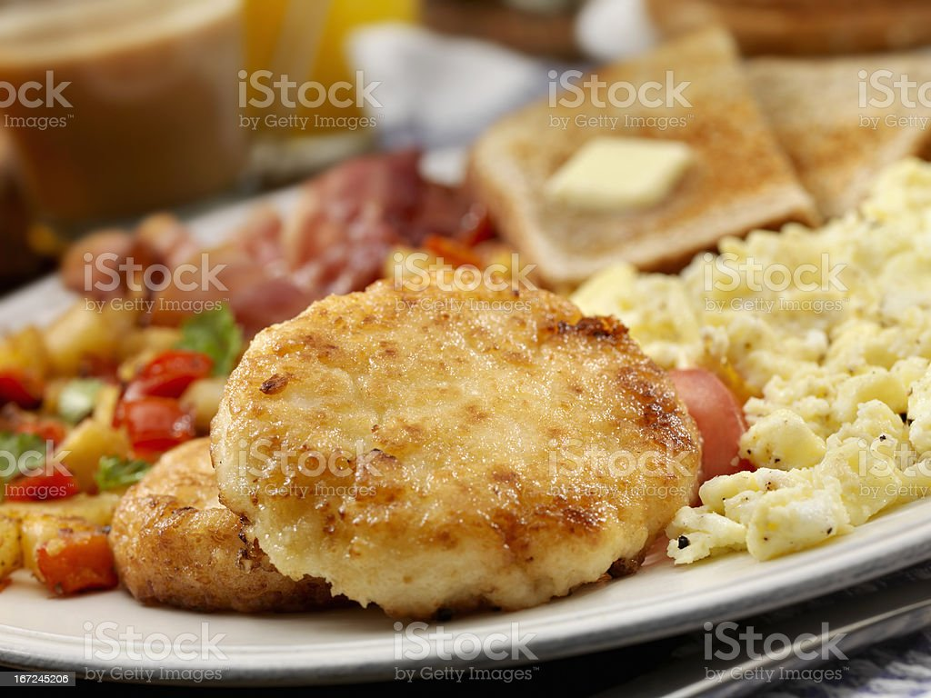Grit Cakes with Bacon and Eggs stock photo