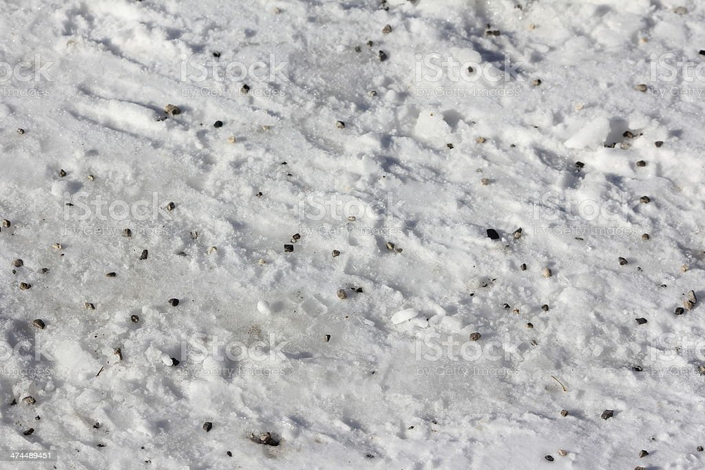 Grit in Snow, Road Pavement, Winter, Crushed Stones stock photo