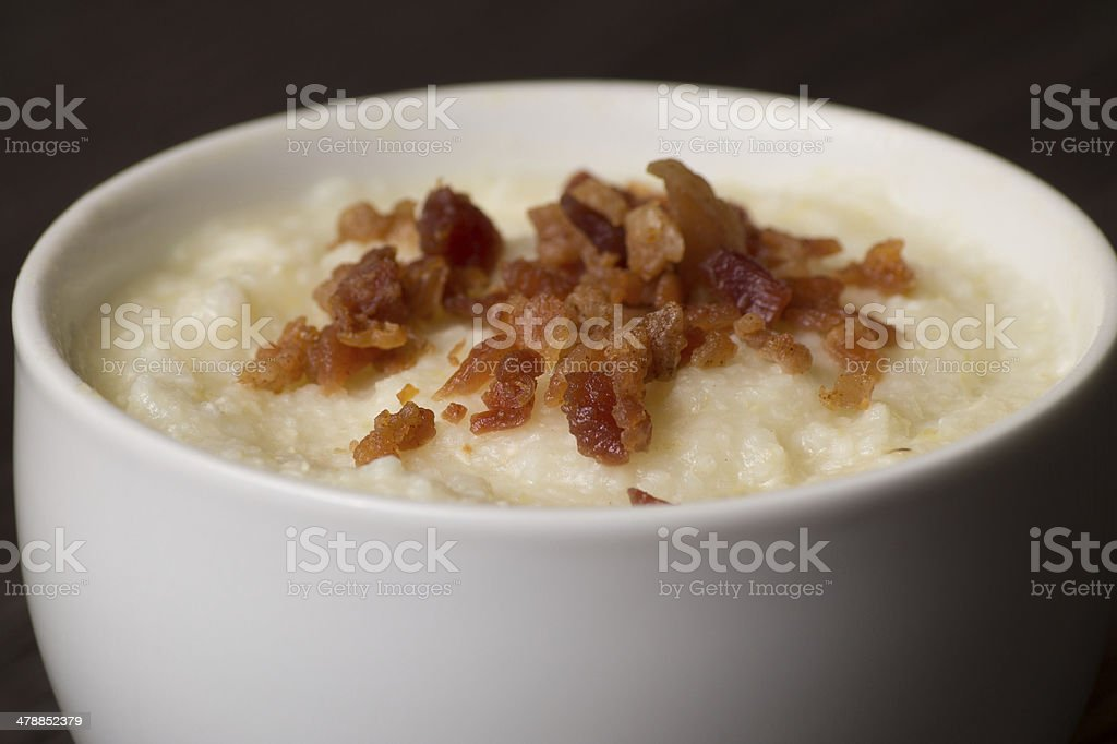 Grits topped with bacon stock photo