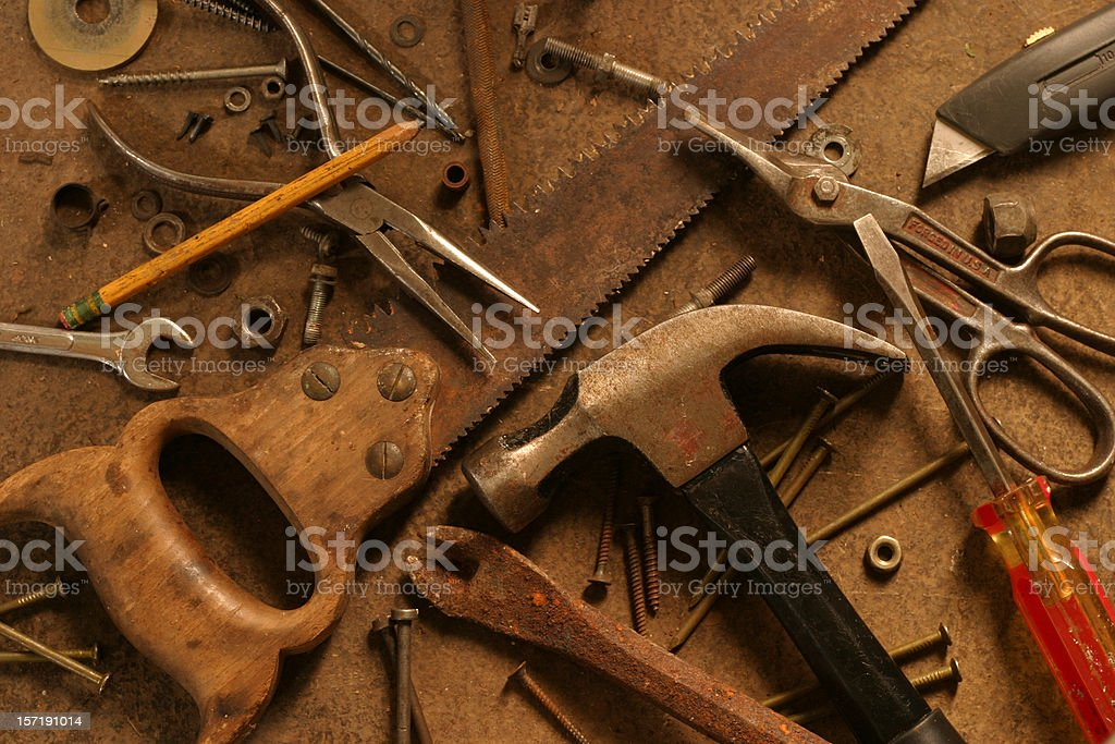 Gritty Hand Tools Scattered Across Grungy Surface royalty-free stock photo