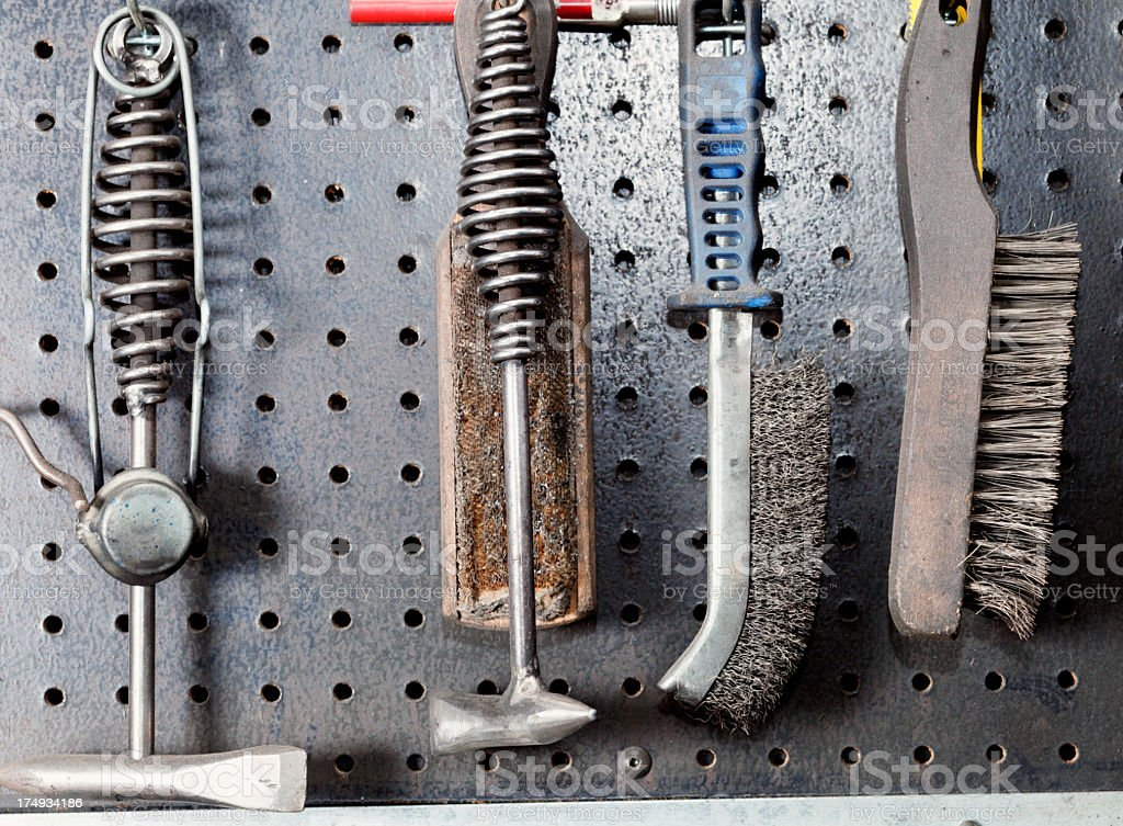 Gritty work tools on the wall royalty-free stock photo
