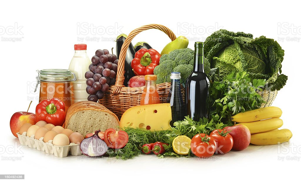Groceries in wicker basket including vegetables and fruits royalty-free stock photo