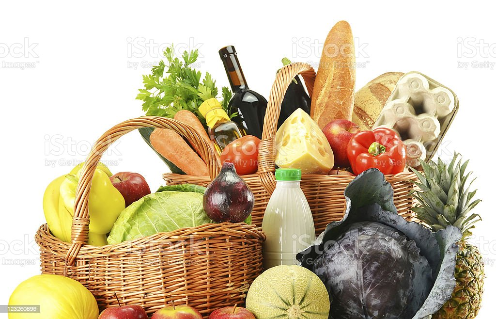 Groceries in wicker basket isolated on white royalty-free stock photo