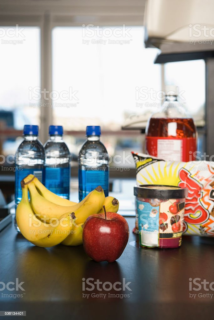 Groceries on a conveyor belt stock photo