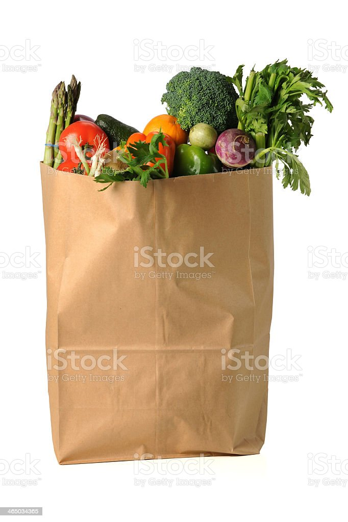 Grocery bag full of fresh fruits and vegetables  stock photo