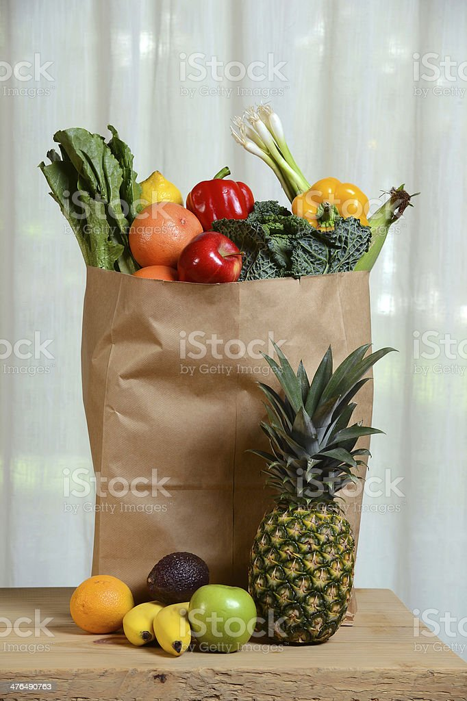 Grocery Brown Bag With Fruits and Vegetables royalty-free stock photo