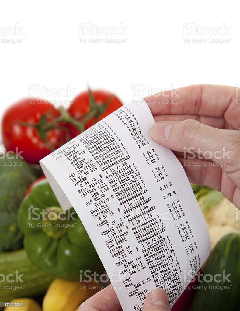 Grocery List over a bag of vegetables stock photo