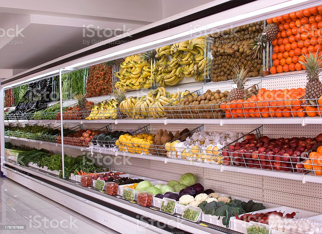 Grocery produce section with colorful refrigerated fruit royalty-free stock photo