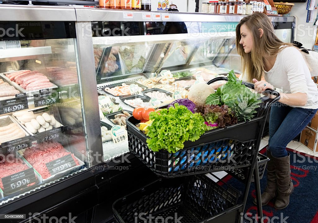 Grocery Shopping in Fish Dept. stock photo