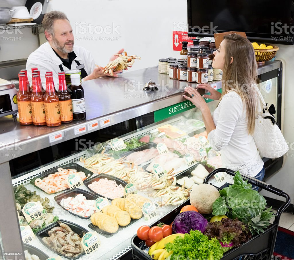 Grocery Shopping in Meat Dept. stock photo