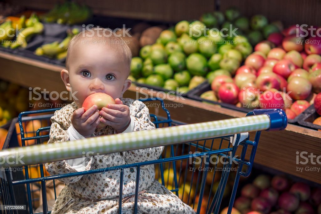 grocery shopping with baby stock photo