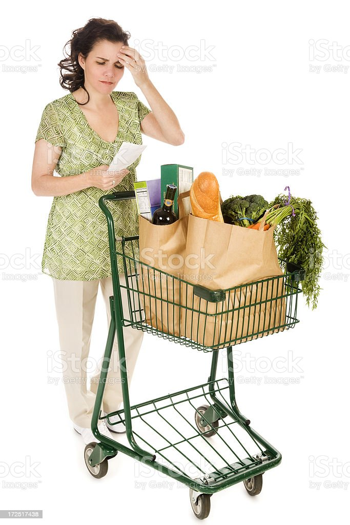 Grocery Shopping Woman Examining Receipt royalty-free stock photo