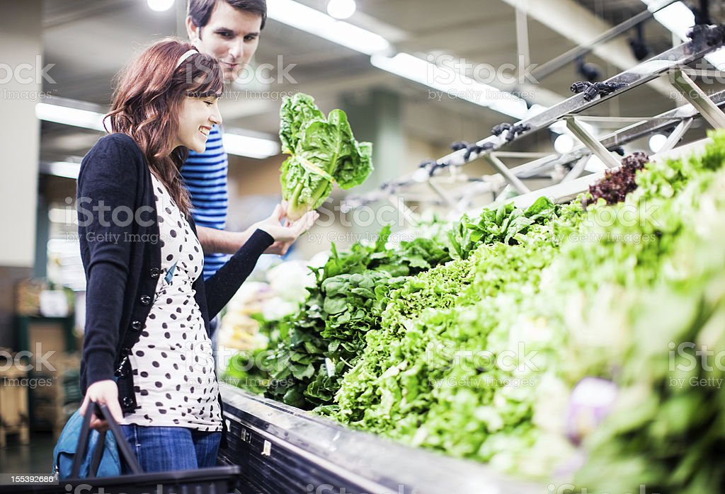 Grocery Shopping Young Couple at Store stock photo