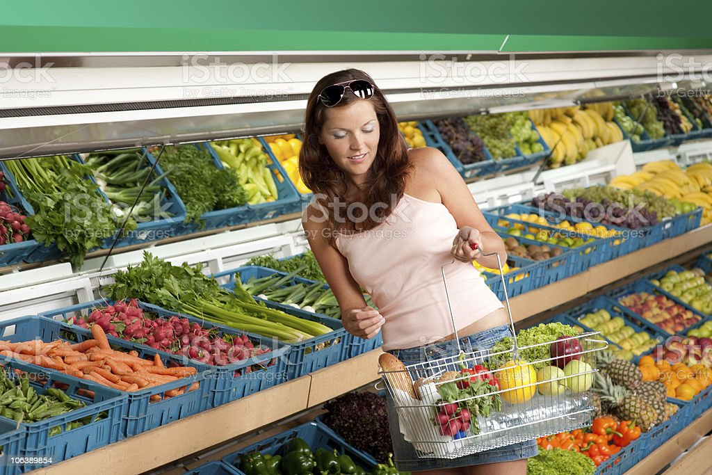 Grocery store - Attractive woman shopping in supermarket royalty-free stock photo
