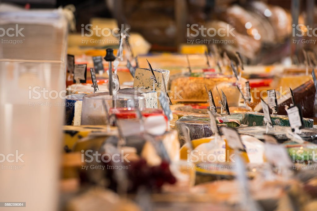 Grocery store. Cheese glass case closeup stock photo