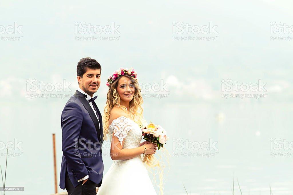 groom and beautiful bride stock photo