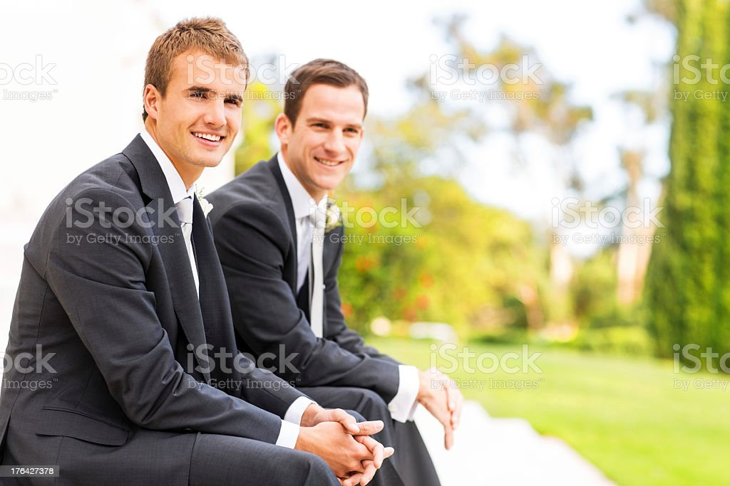 Groom And Best Man Sitting With Hands Clasped royalty-free stock photo