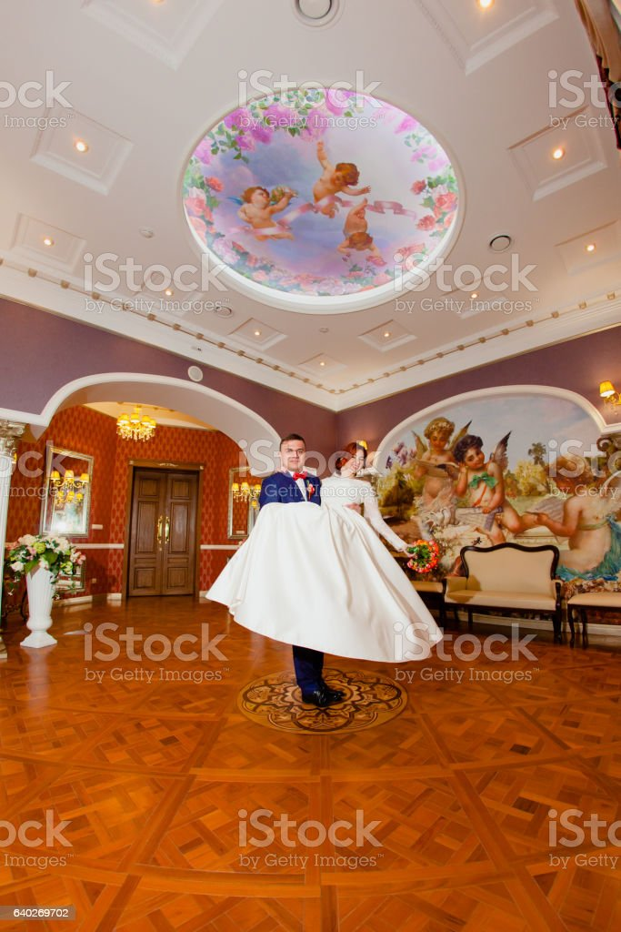 Groom and bride portraits in the beautiful classic interior stock photo