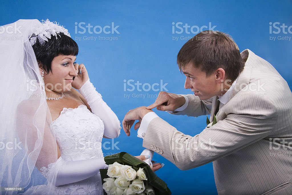 Groom and the bride in a conflict situation royalty-free stock photo