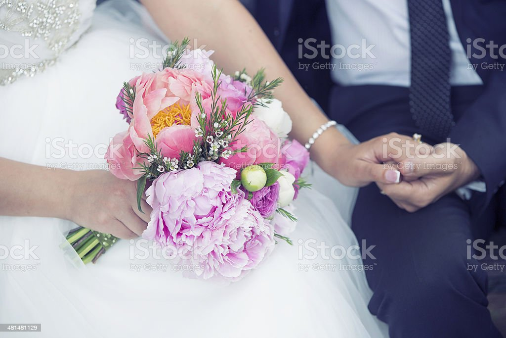 groom and the bride with wedding bouquet royalty-free stock photo