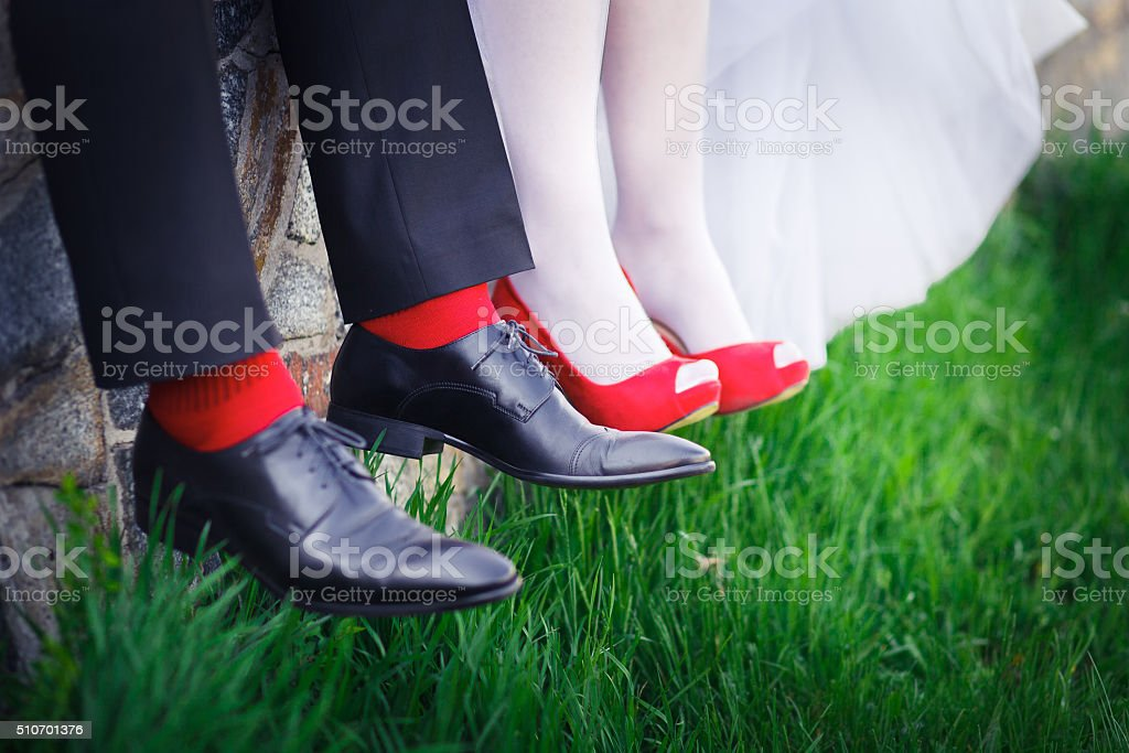 groom. bride, wedding shoes, red stock photo