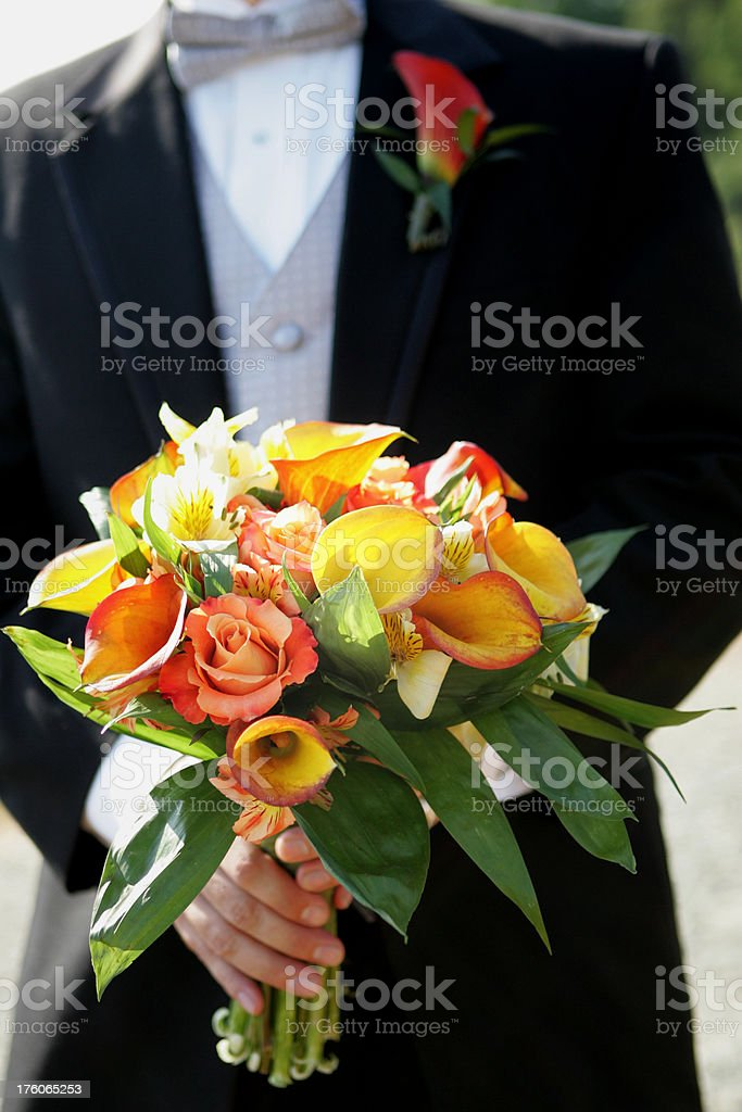 Groom holding a bouquet royalty-free stock photo
