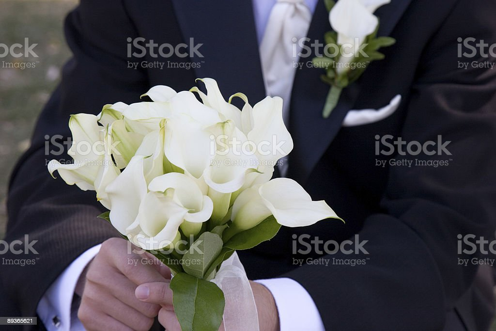 Groom holding bouquet royalty-free stock photo