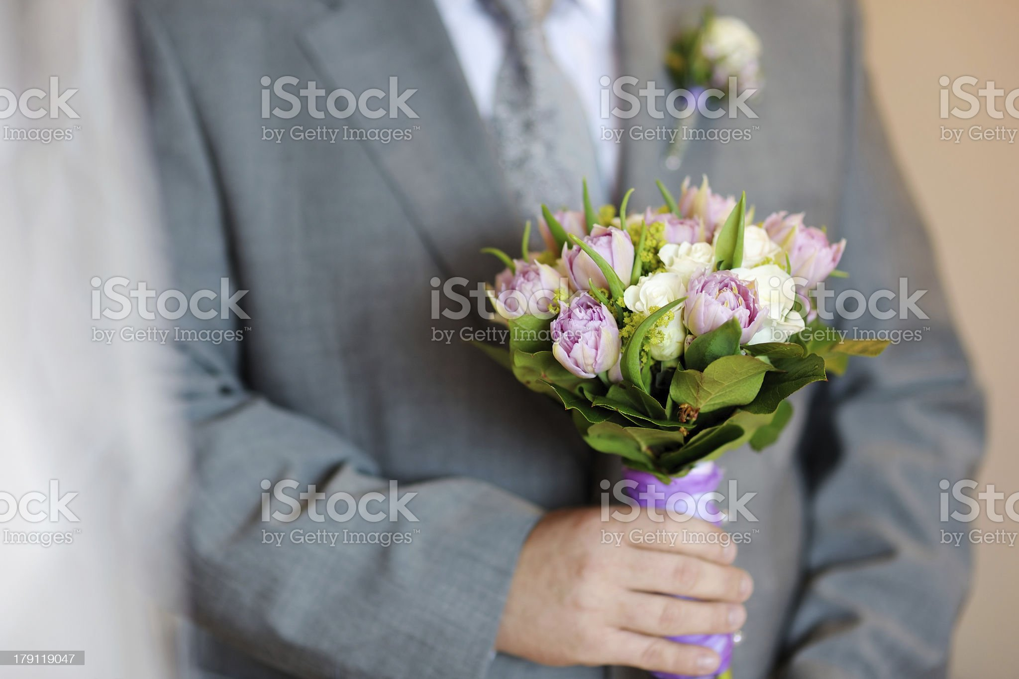 Groom holding flowers royalty-free stock photo