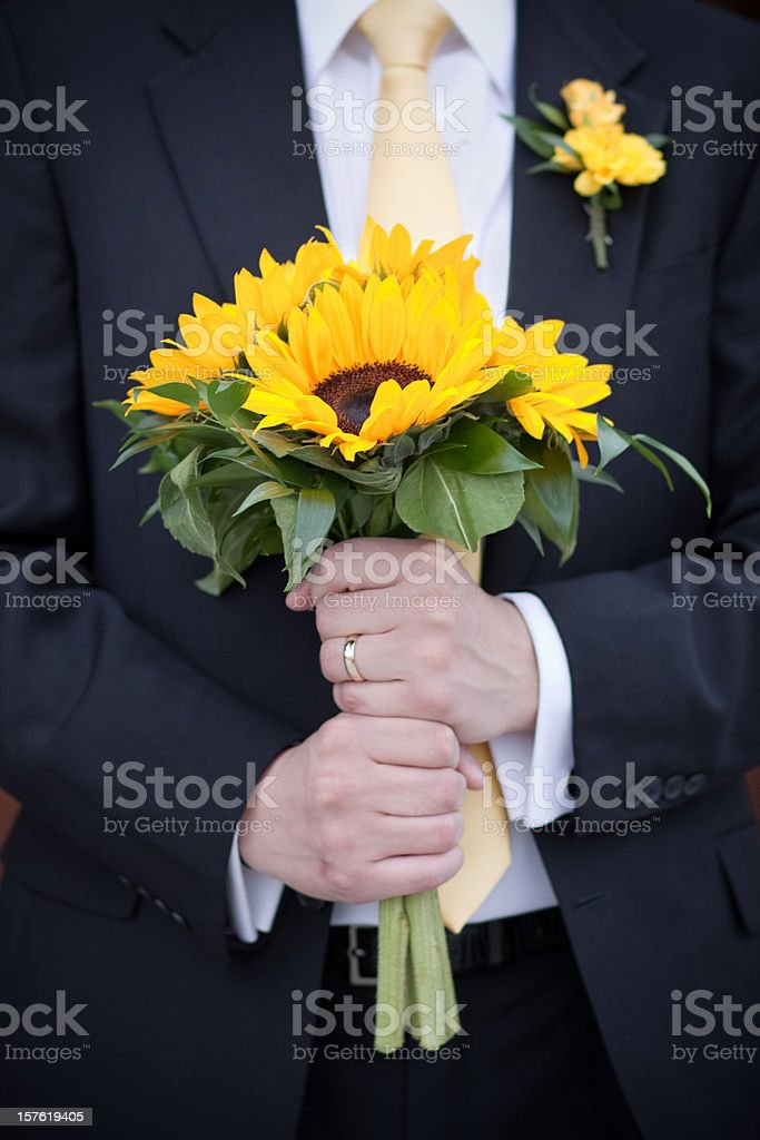 Groom Holding Sunflower Wedding Bouquet stock photo
