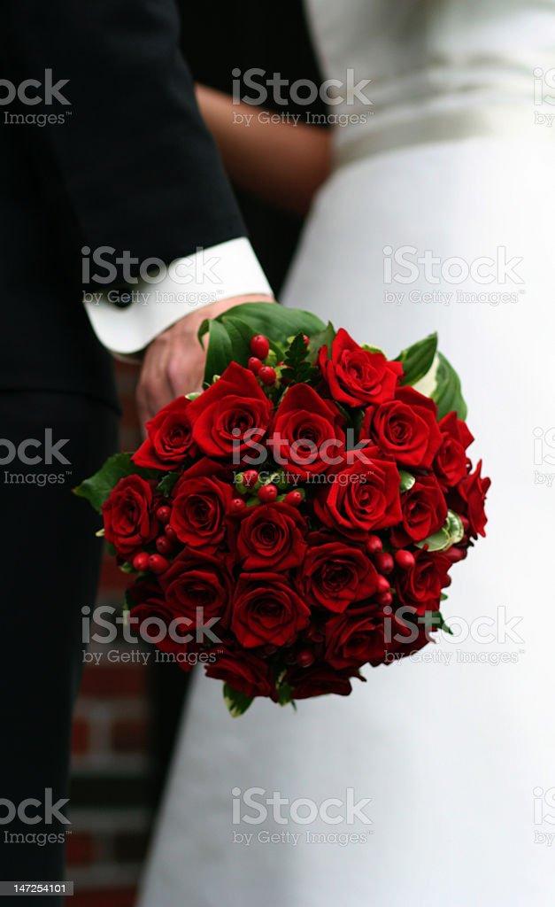 groom holding wedding bouquet royalty-free stock photo