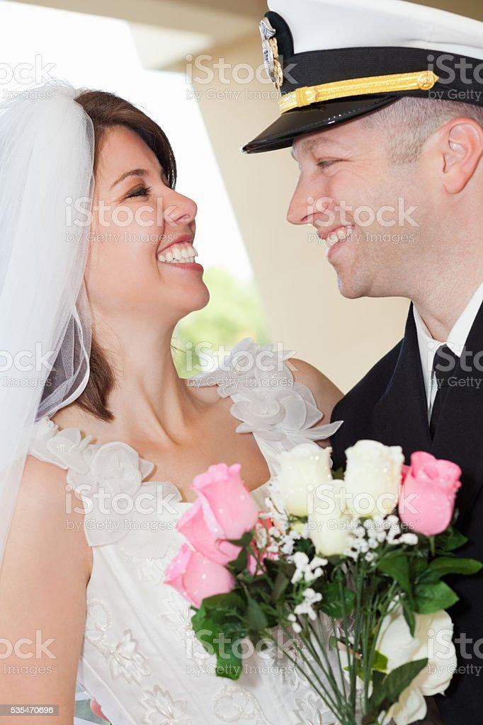 Groom in Navy uniform and his bride stock photo