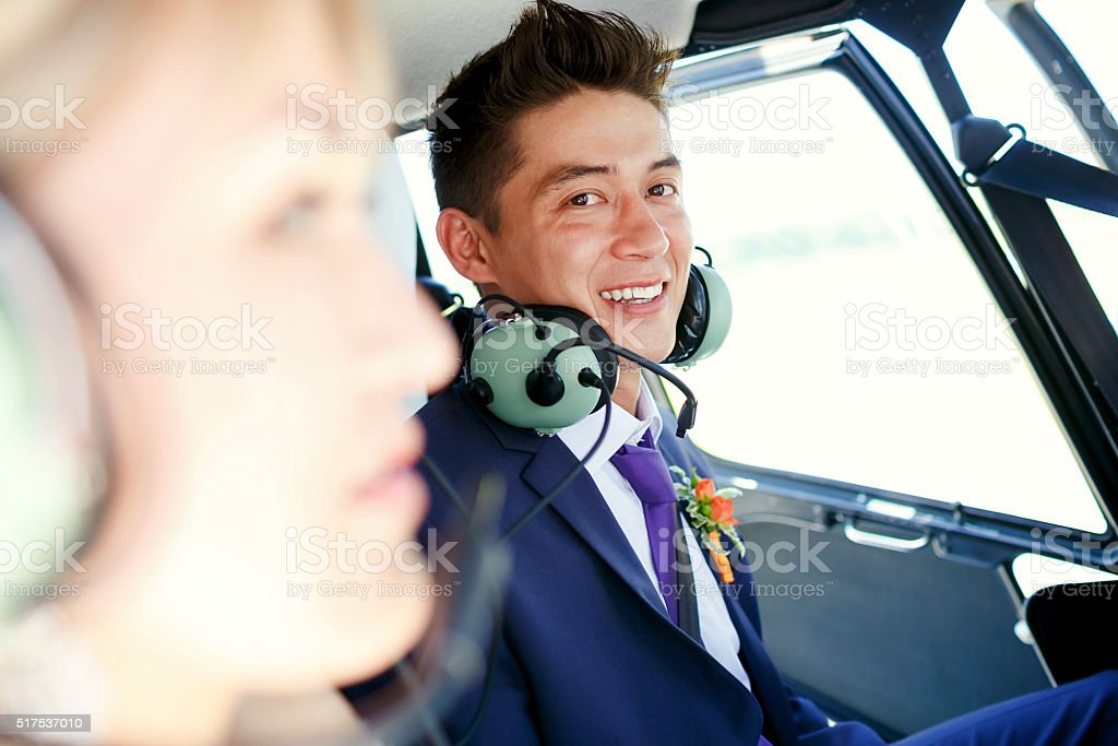 Groom inside a helicopter stock photo