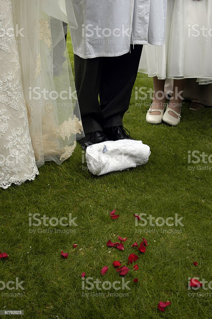 Groom is about to break the glass in Jewish Wedding royalty-free stock photo