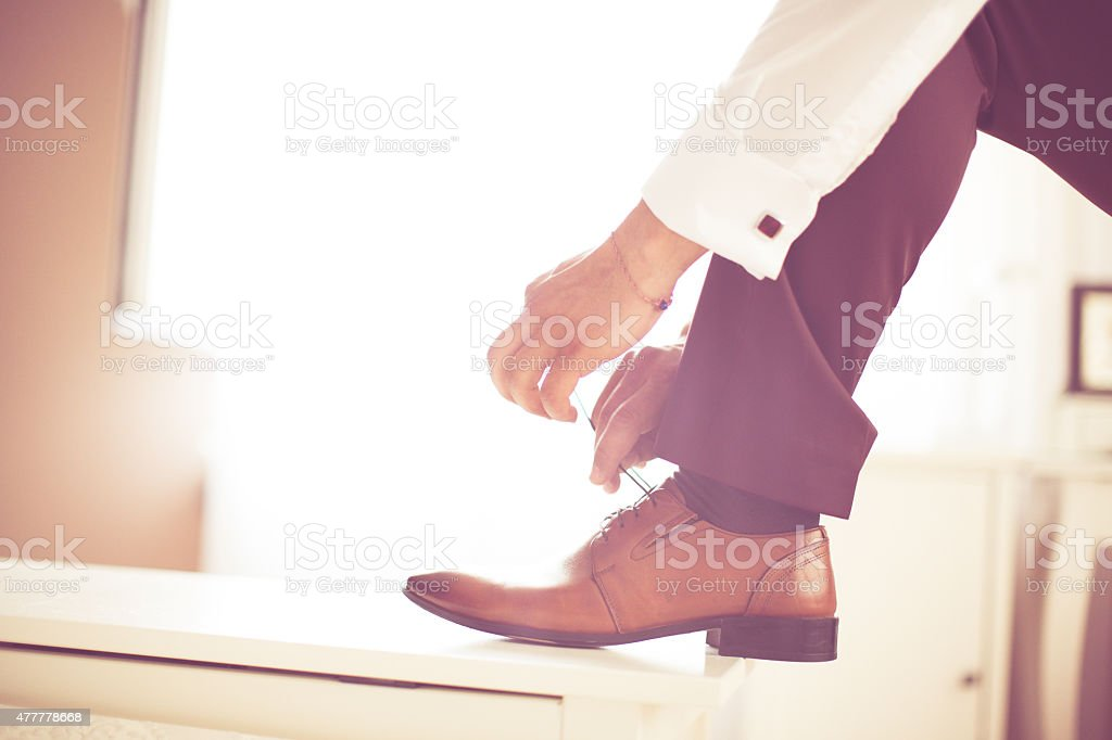 Groom is getting ready for event stock photo
