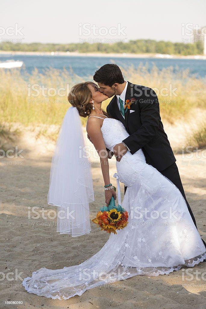 Groom Kissing His Bride royalty-free stock photo