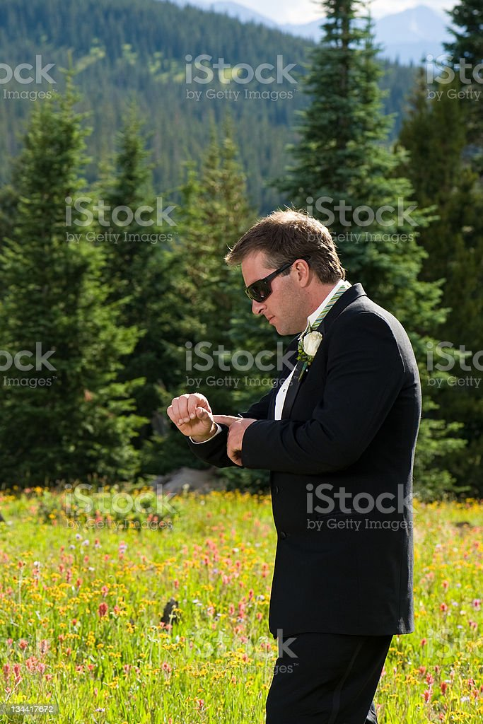 Groom Looking at Watch Before Wedding royalty-free stock photo