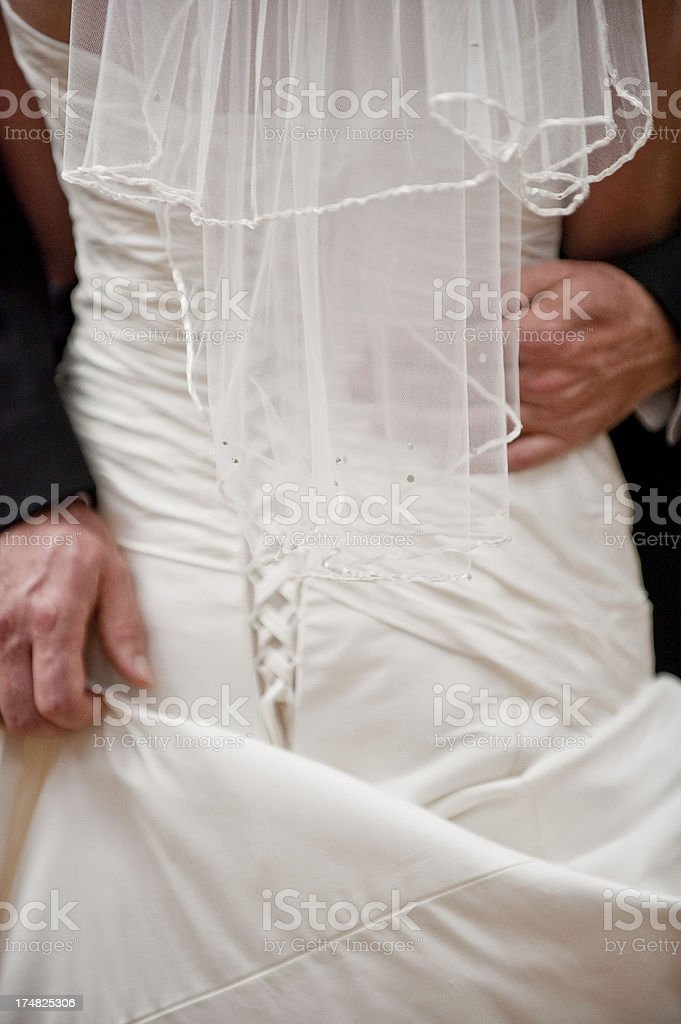 Groom Passionate Embrace of Bride on Wedding Day royalty-free stock photo