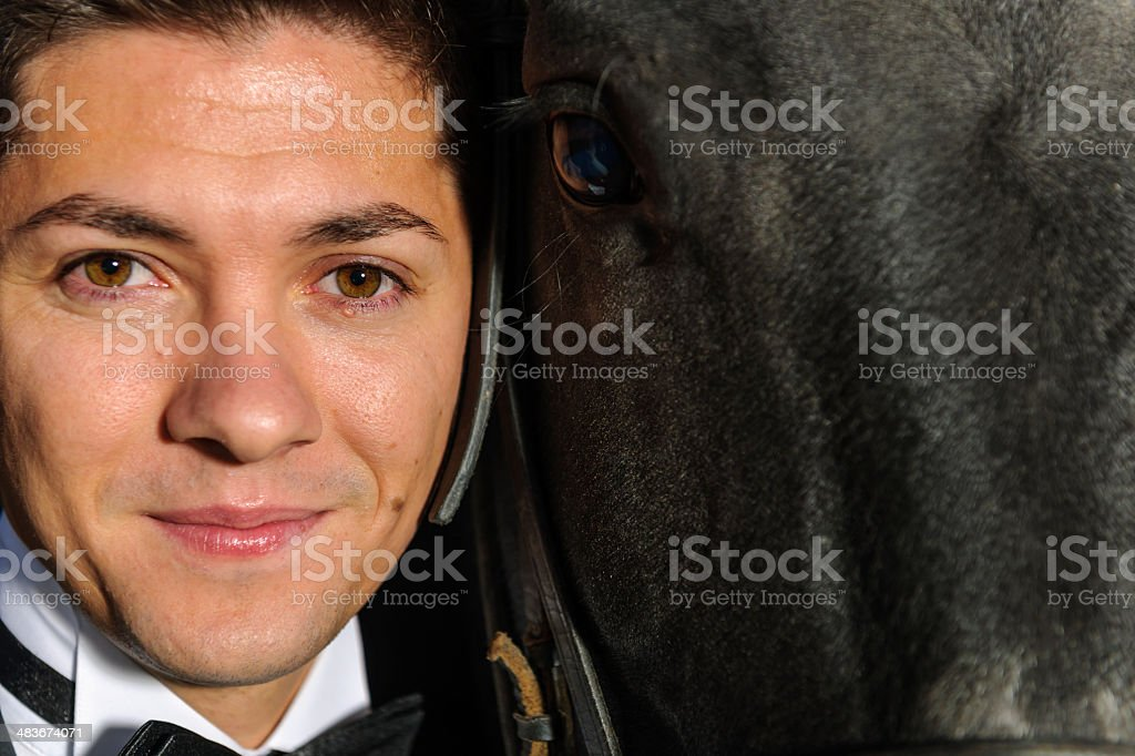 groom portrait and horse eye royalty-free stock photo