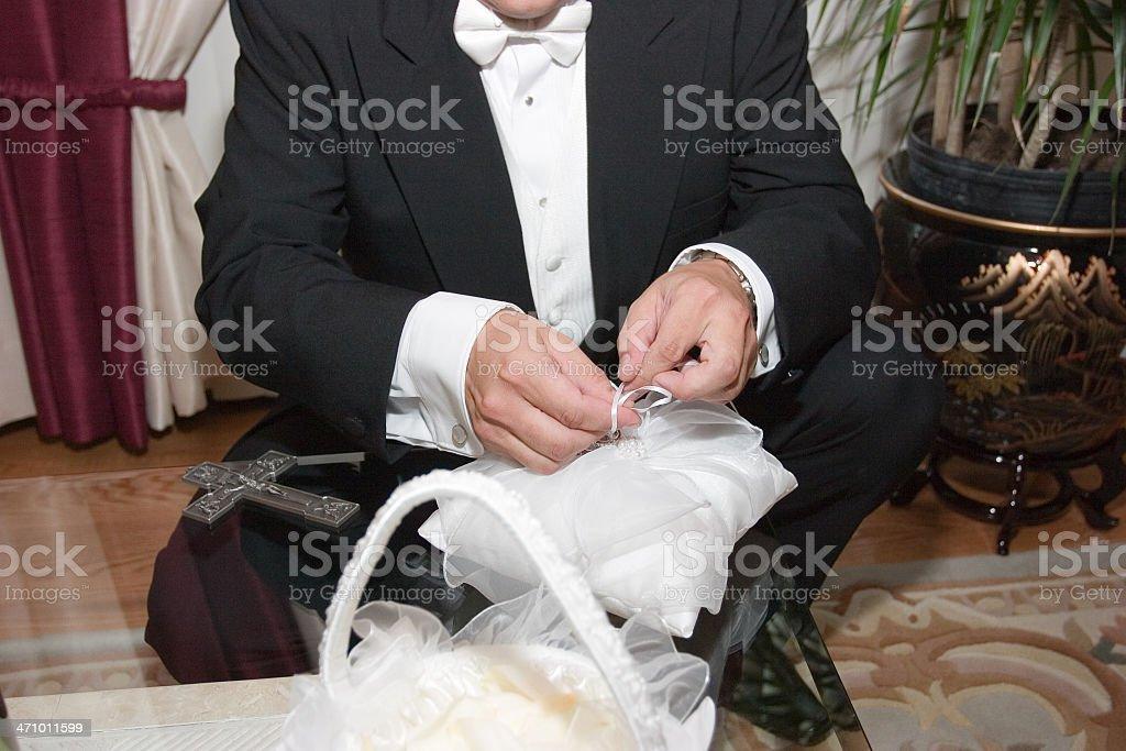 Groom preparing rings stock photo
