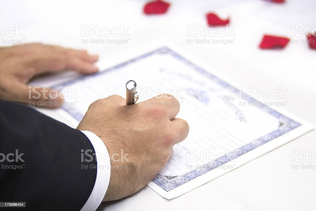 Groom Signing Marriage Certificate stock photo