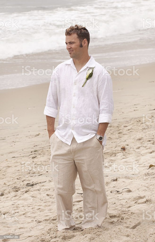 Groom standing on a beach royalty-free stock photo