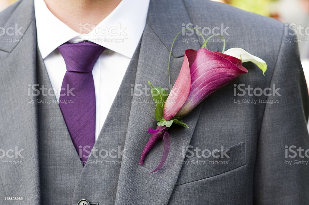 groom wearing a lily buttonhole royalty-free stock photo
