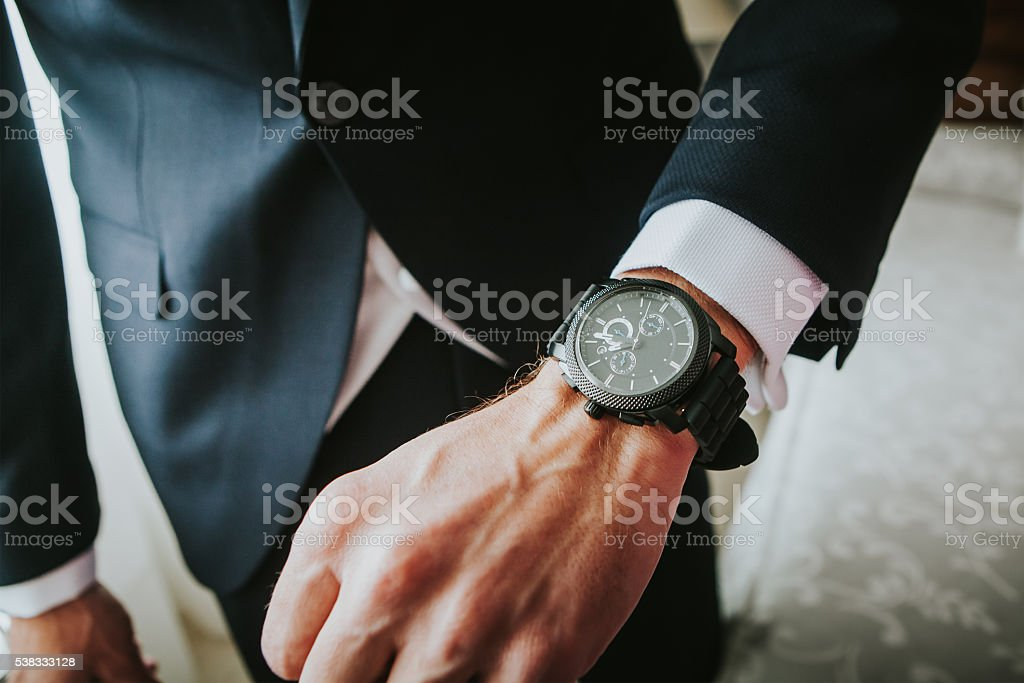Groom wearing a new watch in the wrist. stock photo