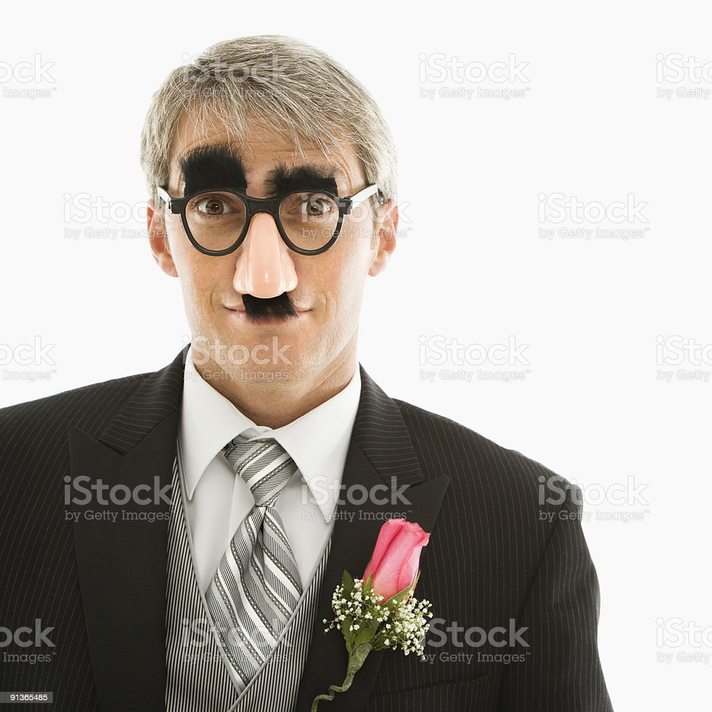 Groom wearing groucho glasses. stock photo