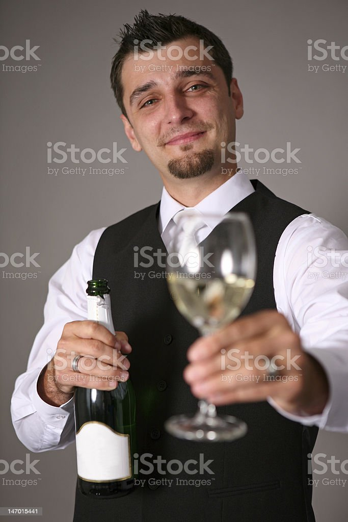 groom with a champagne bottle royalty-free stock photo