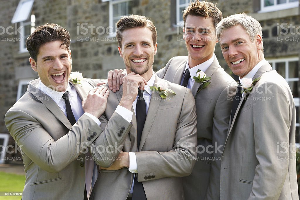 Groom With Best Man And Groomsmen At Wedding stock photo