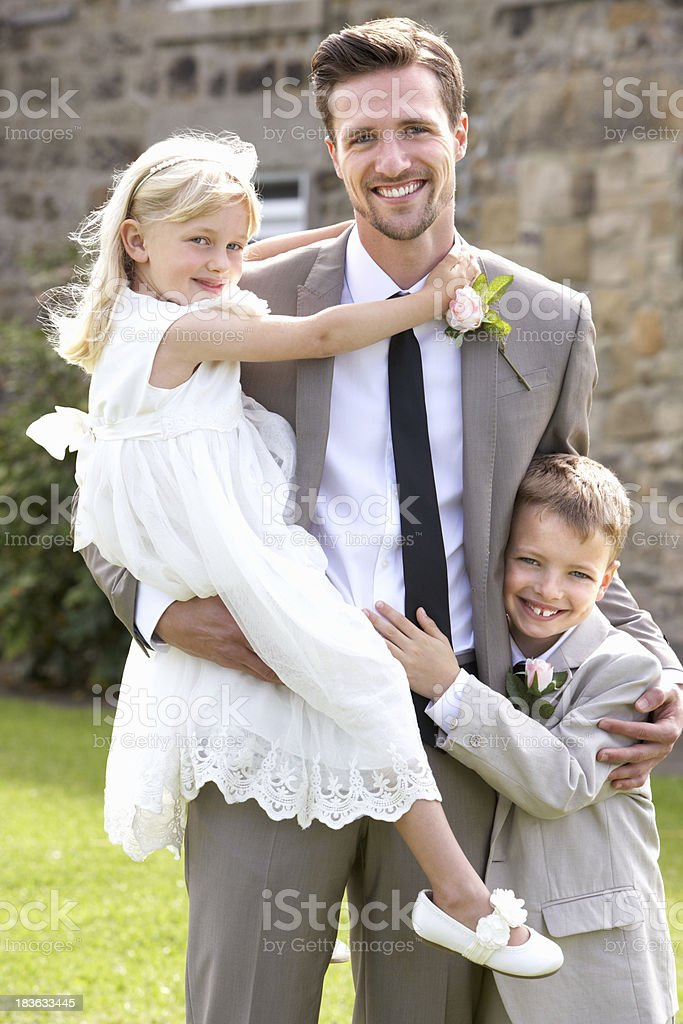 Groom With Bridesmaid And Page Boy At Wedding royalty-free stock photo