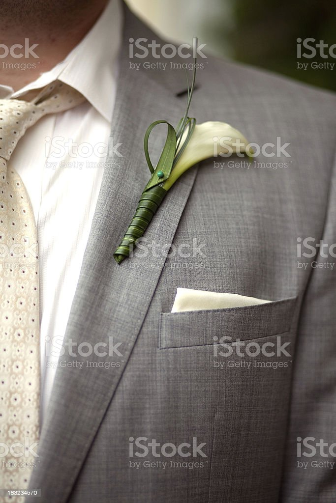 Groom with lily boutonniere stock photo